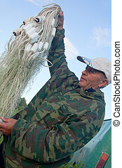 A man holding a fishing net