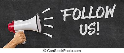 A man holding a megaphone - Follow us