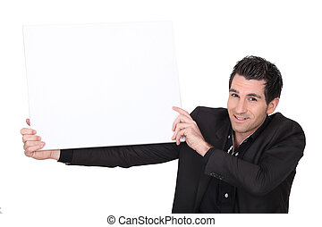 a man holding a white panel