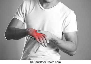 A man holding hands. Pain in the wrist. The hearth is highlighted in red. Close up. Isolated background