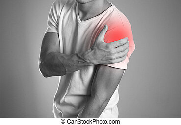 A man holding hands. Shoulder pain. The hearth is highlighted in red. Close up. Isolated background