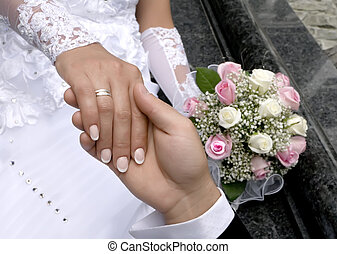 a man holds the hand of woman