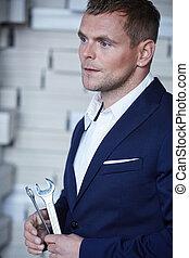 A man in a blue suit.
