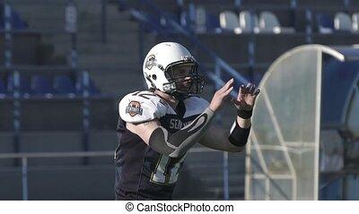 A man in a football uniform makes a throw HD
