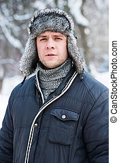 man in a fur winter hat - a man in a fur winter hat with ear...