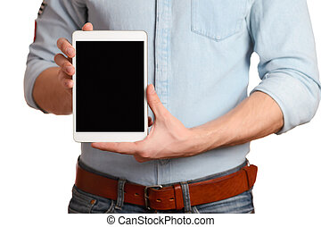 A man in a light blue shirt is holding tablet pc isolated on white, pointing to the screen tablet PC