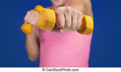 A man in a pink T-shirt with a deep neckline is boxing...