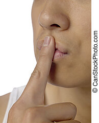 a man in a silence gesture