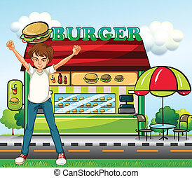 A man in front of the burger stand