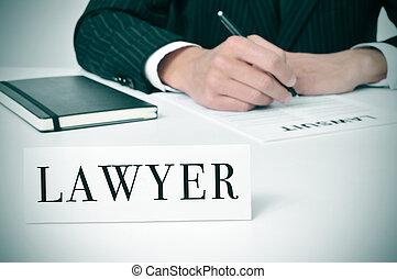 a man in his desk with a nameplate in front of him with the word lawyer written in it