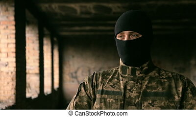 A man in uniform and a black mask - Soldier in uniform and...