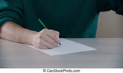 A man is knocking on the table with a pen - indoor