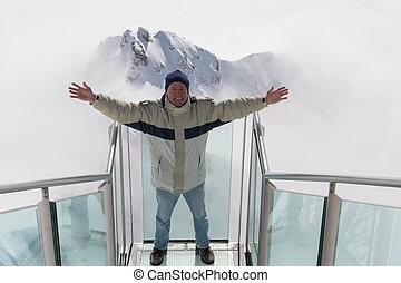 A man is pleased am Dachstein - Mann steht erfreut auf der...