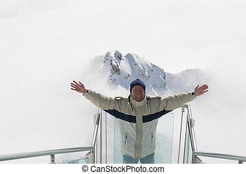 A man is pleased am Dachstein - Mann steht freudig auf der...