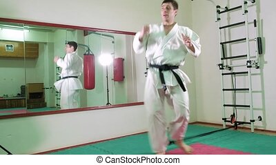 A man is practicing and doing karate exercises 4k - A man is...