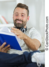 a man is reading a book