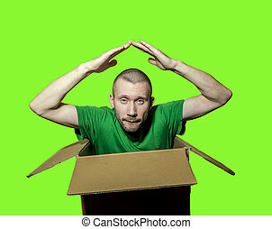 A man is sitting in a close box and folded his arms over his head