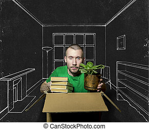 A man is sitting in a tight box and holds in his hands the books and flower