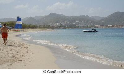 A man jogging along the shoreline