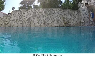 a man jumping in the pool