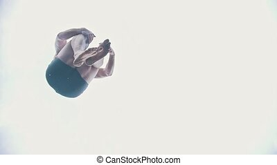 A man jumps a bomb in the river, slow motion, telephoto shot