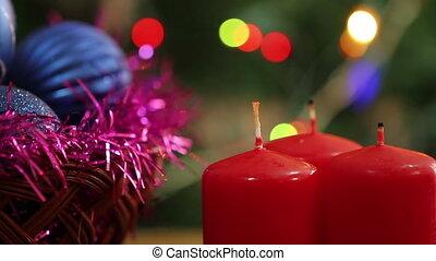 A man lights a Christmas candle.