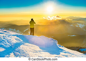 A man looking at beautiful sunset