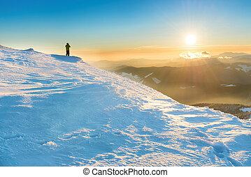 A man looking at beautiful sunset - A man looking at sun and...