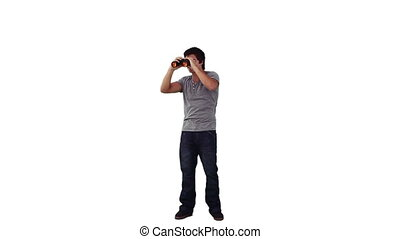 A man looking through binoculars against a white background