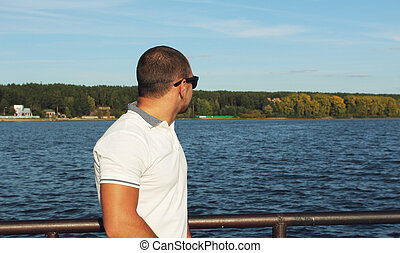 A man looks at sea