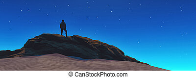 A man looks at the stars