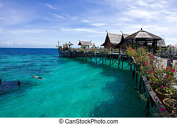 A man-made Kapalai island with exotic tropical resort