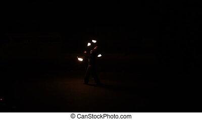 a man makes fire show