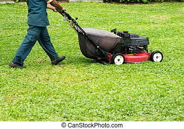 A man mowing the lawn