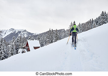 A man on a lonely ski tour in the alps