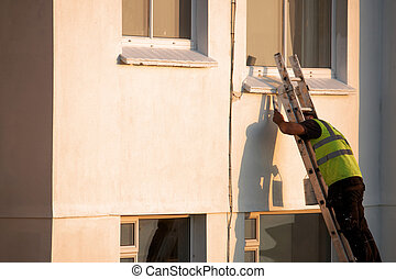 A man painting a building