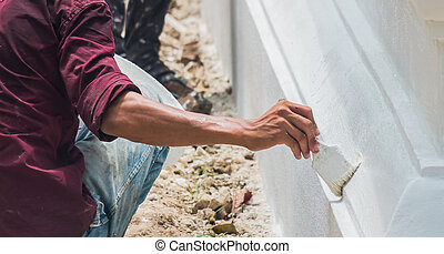 a man painting the wall