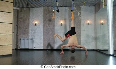 A man performs exercises alfagraviti in the studio 4k