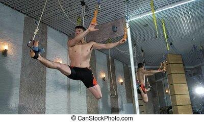 A man performs exercises alfagraviti in the studio 4k