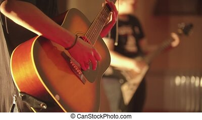 A man playing acoustic guitar - a band performance in the club