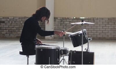 A man playing drums and preparing for the repetition. Mid...
