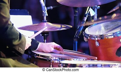 A man playing drums at the jazz concert. Mid shot
