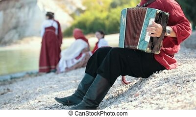 A man playing on accordion, russian national folklore and...