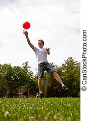 a man playing volleyball