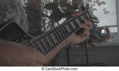 A man plays a solo on an electric guitar