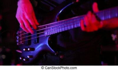 A man plays an electric guitar at a concert