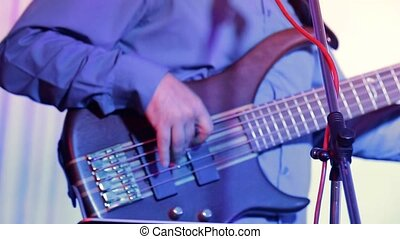 a man plays electric guitar - a man plays guitar