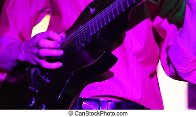 A man plays the guitar - Man lead guitarist playing...