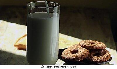 A man pours milk into a glass
