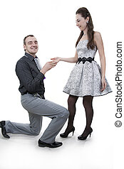 A man proposing marriage to a woman.